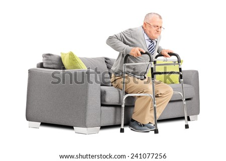 Senior trying to stand up with a walker isolated on white background - stock photo