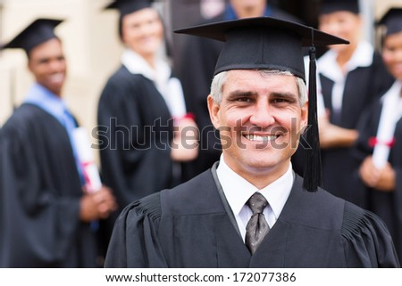 senior university professor in front of group of graduates - stock photo