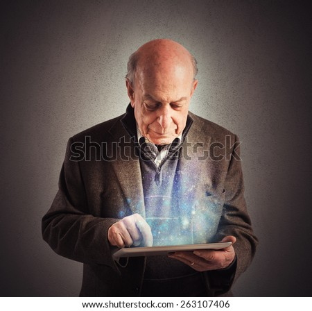 Senior uses tablet to surf the internet