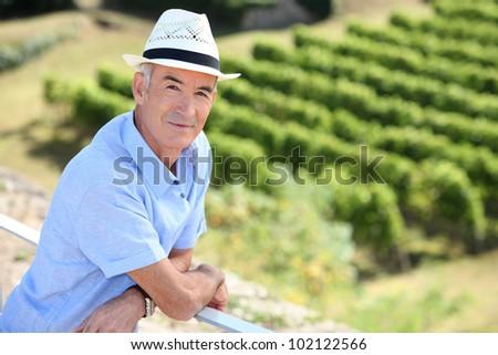 senior visiting a vineyard - stock photo