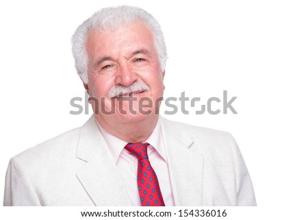 Senior white hair man with a red tie and beige suite smiling satisfied