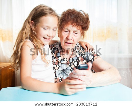 Senior with girl. Generation. Elderly woman with great-grandchild - stock photo