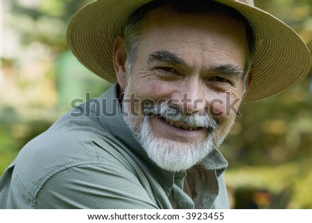senior with straw hat