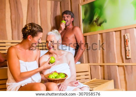 Senior woman and couple sweating in sauna - stock photo