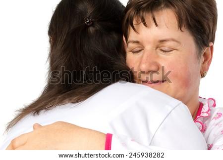 Senior woman and doctor hugging - stock photo