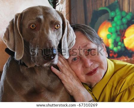 Senior woman and dog - stock photo