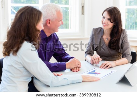 Senior woman and man at retirement financial planning with consultant or adviser - stock photo