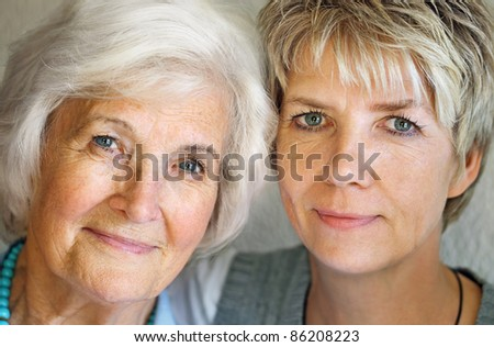 Senior woman and mature daughter portrait - stock photo
