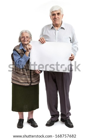 Senior woman and mature man holding holding a blank billboard isolated on white background  - stock photo
