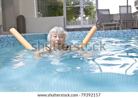 Senior woman aqua fitness - stock photo