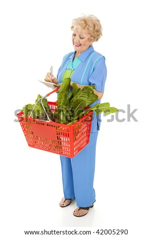 Senior woman at the grocery store, checking her shopping list.  Full body isolated. - stock photo