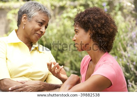 Senior Woman Being Consoled By Adult Daughter - stock photo