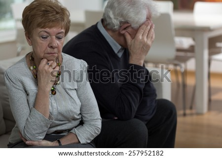 Senior woman being offended at her husband - stock photo