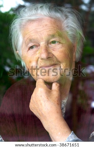 Senior woman contemplating - stock photo