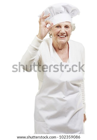 senior woman cook doing an excellent symbol against a white background - stock photo