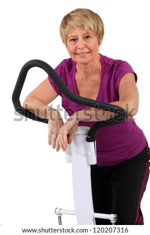 senior woman doing exercises in the gym - stock photo
