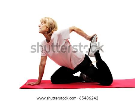 Senior woman doing fitness exercises - stock photo