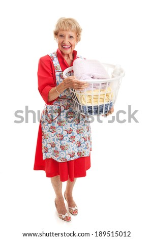 Senior woman dressed in retro fashion carrying a basket of laundry.  Full body isolated.