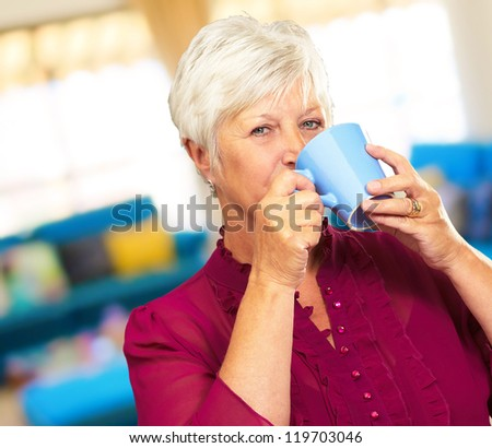 Senior Woman Drinking From Cup, Indoor - stock photo