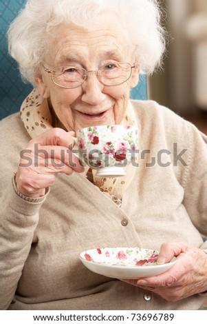 Senior Woman Enjoying Cup Of Tea At Home - stock photo