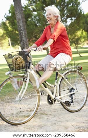 Senior Woman Enjoying Cycle Ride - stock photo