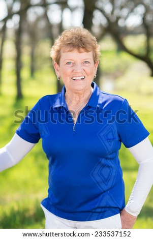 Senior woman exercising with suspension trainer in park for sport fitness - stock photo