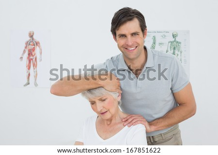 Senior woman getting the neck adjustment done in the medical office - stock photo