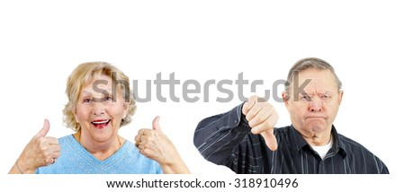 Senior woman giving two thumbs up and grumpy man thumb down