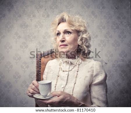 Senior woman having a cup of tea