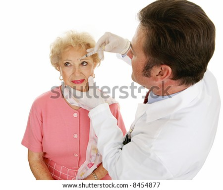 Senior woman having cosmetic injections to fill in wrinkles.  Isolated on white.
