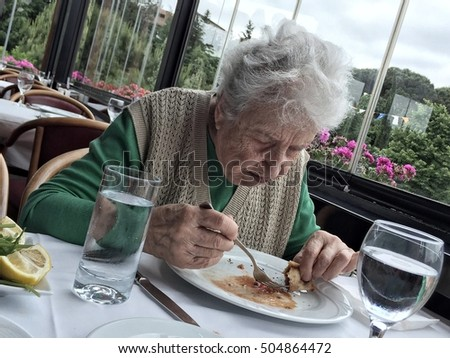 senior woman having lunch in a cafe
