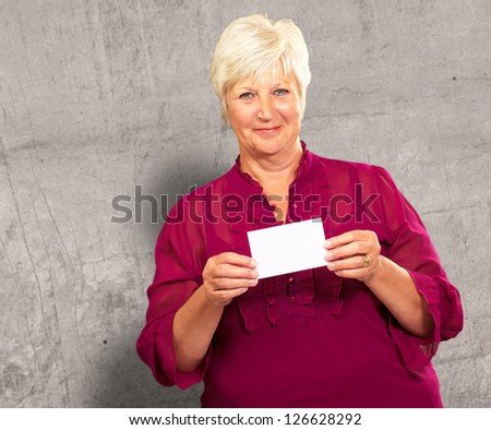 Senior Woman Holding A Card, Indoor - stock photo