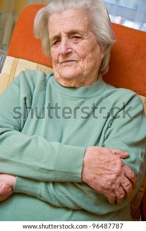 Senior woman holding painful arm - stock photo