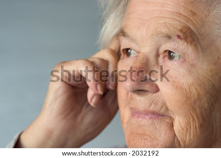 Senior woman leaning on her hand.