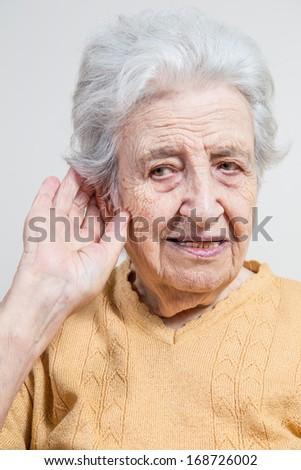 senior woman listening / trying to hear - stock photo