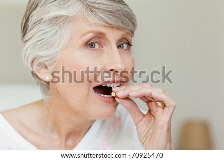 Senior woman looking at the camera - stock photo