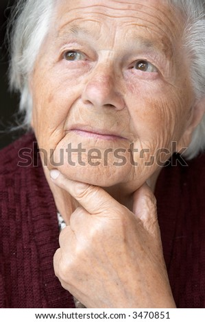 Senior woman looking away, portrait - stock photo