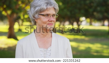 Senior woman looking off into the distance - stock photo