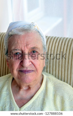 senior woman looking to camera - indoor - stock photo