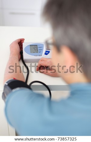 senior woman measured her blood pressure