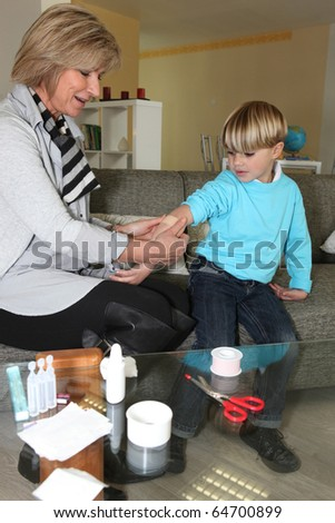 Senior woman nursing a little boy