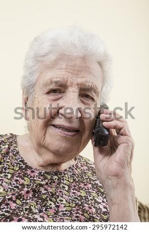 senior woman on phone - stock photo