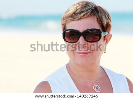 senior woman on summer vacation at sea