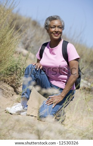 Senior woman on walk in countryside
