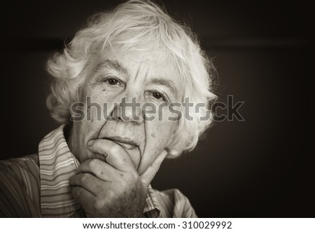 Senior woman pensive and worried. Black and white photo - stock photo