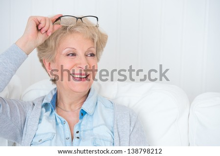 Senior woman portrait, at home with white hair - stock photo