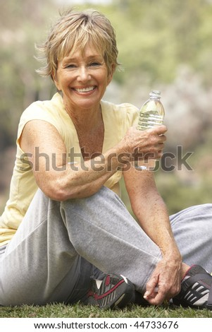Senior Woman Relaxing After Exercise - stock photo