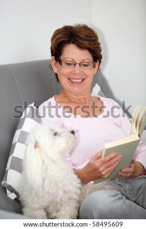 Senior woman relaxing at home - stock photo