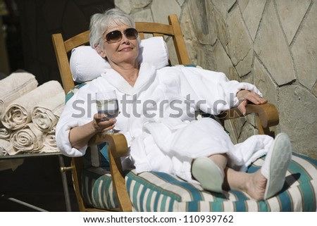 Senior woman relaxing in a spa - stock photo