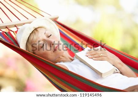 Senior Woman Relaxing In Hammock - stock photo